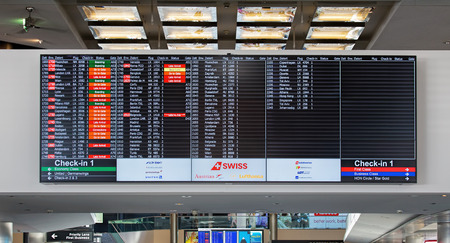 arrival departure board: Kloten, Switzerland - 4 July, 2015: arrival departure board in the Zurich Kloten Airport, also known as Zurich Airport. Zurich Kloten Airport is the largest international airport of Switzerland and the principal hub of Swiss International Air Lines. Editorial