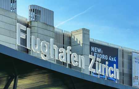 signage outdoor: Kloten, Switzerland - 4 July, 2015: upper part of the Zurich Kloten Airport also known as Zurich Airport building, right above the main entrance. Zurich Kloten Airport is the largest international airport of Switzerland and the principal hub of Swiss Inte