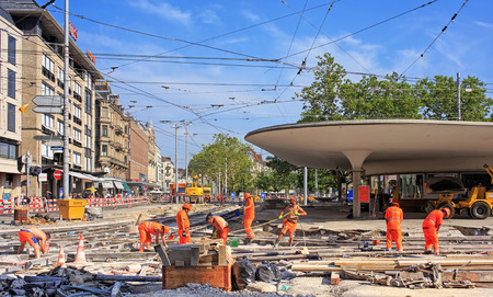 road works: Zurich, Switzerland - 16 July, 2015: road works on the Bellevue square. Bellevue square is a town square named after the Grandhotel Bellevue built in 1856, and is one of nodal points of the road and public transportation. Editorial
