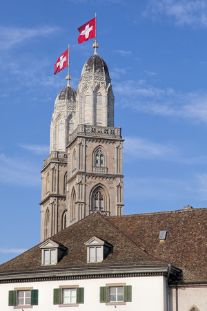 grossmunster cathedral: Grossmunster towers decorated with flags of Switzerland.