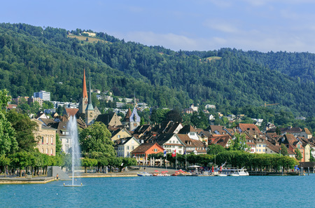 Zug, Switzerland - 14 July, 2015: view on the city over the Lake Zug. Zug is a city in Switzerland, it is the capital of the Canton of Zug. Sajtókép