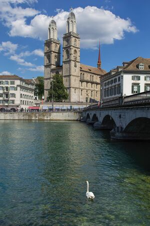 grossmunster cathedral: Zurich, Switzerland - 30 July, 2015: view on the Limmatquai quay and the Grossmunster cathedral. Zurich is the largest city in Switzerland, it is also the capital of the Canton of Zurich.