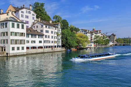 felix: Zurich, Switzerland - 9 August, 2015: view on the Limmat river with the Felix ship passing. Zurich is the largest city in Switzerland and the capital of the Canton of Zurich.