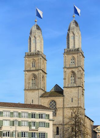 grossmunster cathedral: Towers of the Grossmunster cathedral decorated with flags of Zurich
