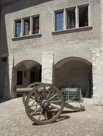 old time: Thun, Switzerland - 21 July, 2015: old time cannon in the courtyard of the Thun Castle. Thun Castle German: Schloss Thun is a castle in the city of Thun, in the Swiss canton of Bern. It was built in the 12th century, today houses the Thun Castle museum, a