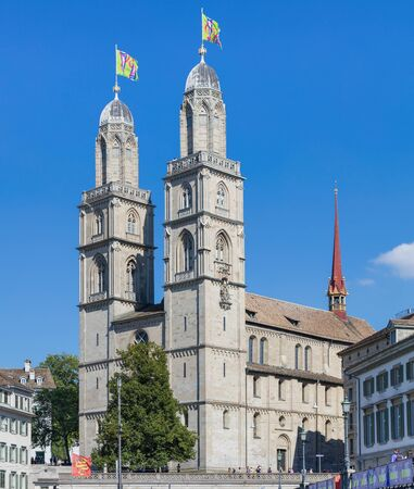 grossmunster cathedral: Zurich, Switzerland - 21 August, 2015: Grossmunster cathedral decorated with flags. Zurich is the largest city in Switzerland and the capital of the Canton of Zurich.