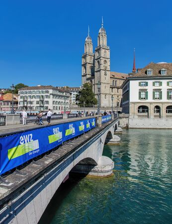 grossmunster cathedral: Zurich, Switzerland - 21 August, 2015: the Munsterbrucke bridge and the Grossmunster cathedral. Zurich is the largest city in Switzerland and the capital of the Canton of Zurich.
