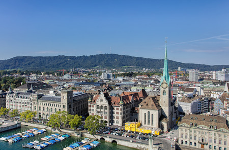 grossmunster cathedral: Zurich, Switzerland - 31 August, 2015: view from the tower of the Grossmunster cathedral towards Mt. Uetliberg. Zurich is the largest city in Switzerland and the capital of the canton of Zurich.