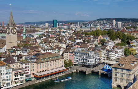 grossmunster cathedral: Zurich, Switzerland - 31 August, 2015: view from the tower of the Grossmunster cathedral with the Felix ship at pier at the hotel zum Storchen. Zurich is the largest city in Switzerland and the capital of the canton of Zurich.