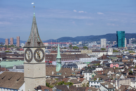 grossmunster cathedral: Zurich cityscape - view from the tower of the Grossmunster cathedral with the St. Peter Church in the foreground.