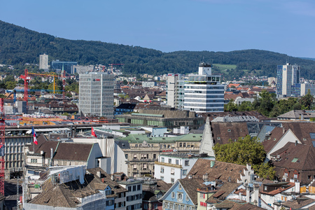 grossmunster cathedral: Zurich, Switzerland - 31 August, 2015: view on the city from the tower of the Grossmunster cathedral. Zurich is the largest city in Switzerland and the capital of the canton of Zurich.