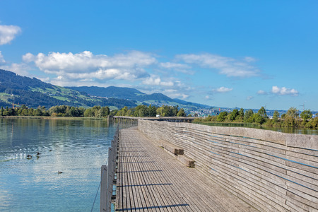 Wooden pedestrian bridge between the city of Rapperswil and the village of Hurden crossing the upper Lake Zurich Obersee in Switzerland German: Holzbrucke Rapperswil-Hurden.