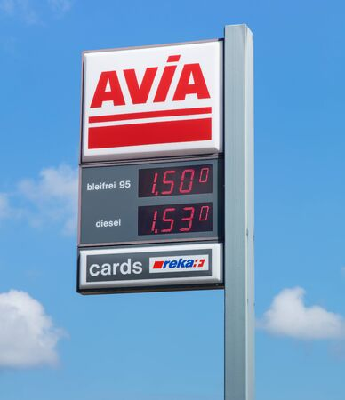 avia: Einsiedeln, Switzerland - 7 September, 2015: AVIA sign with gasoline and diesel prices in Swiss Francs at the filling station. AVIA International is a headquartered in Zurich, Switzerland company, which is currently represented by more than 2900 petrol st