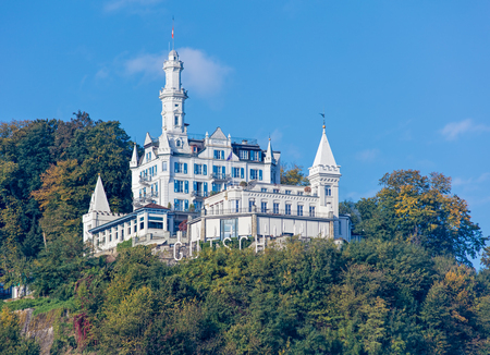 hotel building: Lucerne, Switzerland - 3 October, 2015: the Chateau Gutsch hotel building. Chateau Gutsch is a grand boutique hotel and restaurant housed in one of Switzerlands most famous buildings, dating from 1888.