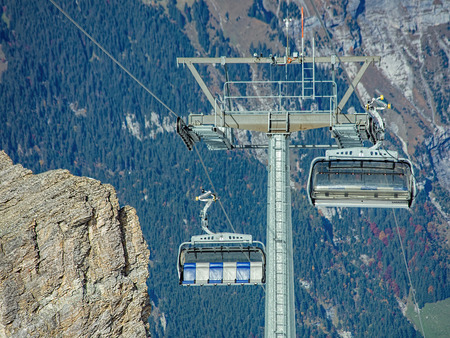 cantons: Mt. Titlis, Switzerland - 12 October, 2015: the Ice Flyer cable car, view from the station on the top of the mount. Titlis also Mount Titlis is a mountain of the Uri Alps, located on the border between the cantons of Obwalden and Berne.  Editorial