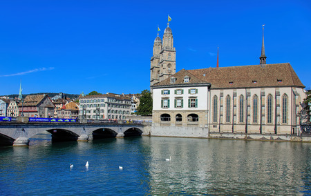 grossmunster cathedral: Zurich, Switzerland - 21 August, 2015: the Limmat river, the Munsterbrucke bridge, the Grossmunster and the Water Church, view from the Stadthausquai quay. Zurich is the largest city in Switzerland and the capital of the canton of Zurich. Editorial