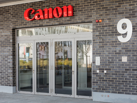 ag: Wallisellen, Switzerland - 13 November, 2015: entrance of the Canon Switzerland AG office building on the Richtistrasse street. Canon is a multinational corporation specialized in the manufacturing of imaging and optical products, including cameras, camco