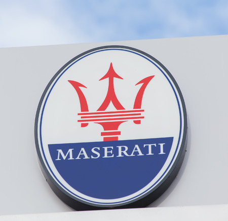 ag: Wallisellen, Switzerland - 13 November, 2015: Maserati sign on the top of the octane 126 AG office building. octane 126 AG provides official Ferrari and Maserati service.