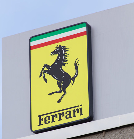 ag: Wallisellen, Switzerland - 13 November, 2015: Ferrari sign on the top of the octane 126 office building. octane 126 AG provides official Ferrari and Maserati service. Editorial
