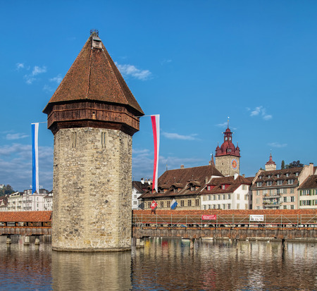 octagonal: Lucerne, Switzerland - 3 October, 2015: the Water Tower German: Wasserturm. The 35 meter high octagonal tower was first mentioned in the year 1367. Editorial