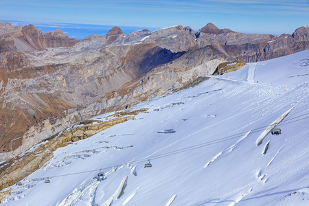 chair on the lift: Mt. Titlis, Switzerland - 12 October, 2015: Ice Flyer chair lift. Titlis is a mountain of the Uri Alps, located on the border between the cantons of Obwalden and Bern.