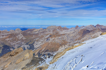 accessed: View from Mt. Titlis in the Swiss Alps in autumn. Titlis is a mountain of the Uri Alps, located on the border between the cantons of Obwalden and Bern. It is mainly accessed from the town of Engelberg Canton of Obwalden