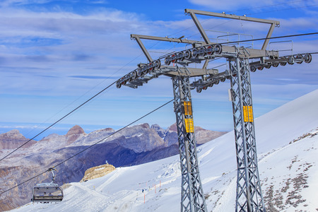 cantons: Mt. Titlis, Switzerland - 12 October, 2015: the Ice Flyer ski lift, view from the station on the top of the mountain. Titlis is a mountain of the Uri Alps, located on the border between the cantons of Obwalden and Berne. At 3,238 metres above sea level,