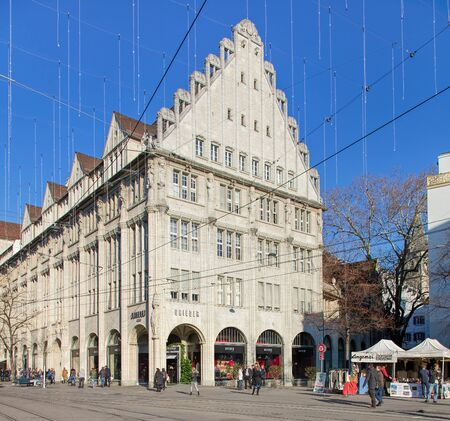 avenues: Zurich, Switzerland - 2 December, 2015: the Bahnhofstrasse street with Christmas illumination lamps, view from the Paradeplatz square. Bahnhofstrasse is Zurichs main downtown street and one of the worlds most expensive and exclusive shopping avenues.