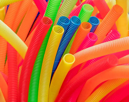 corrugated: Colorful corrugated plastic pipes: red,yellow, blue.