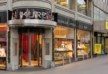 avenues: Zurich, Switzerland - 4 December, 2015: entrance of the Juwelier Kurz store on Bahnhofstrasse decorated for Christmas. Bahnhofstrasse is Zurichs main downtown street and one of the worlds most expensive and exclusive shopping avenues.