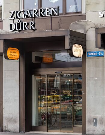 avenues: Zurich, Switzerland - 6 December, 2015: Entrance of the Zigarren Durr store on the Bahnhofstrasse street. Bahnhofstrasse is Zurichs main downtown street and one of the worlds most expensive and exclusive shopping avenues.