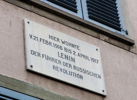 number 14: Zurich, Switzerland - 11 December, 2015: memorial plate on the facade of the house number 14 on the Spiegelgasse street where Vladimir Lenin lived from 21 February 1916 till 2 April 1917. Vladimir Ulyanov, alias Lenin was the leading Russian communist rev
