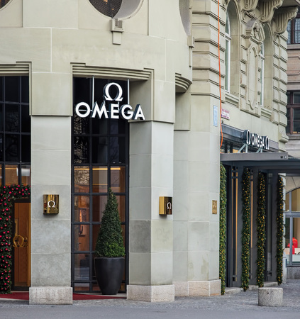 wor: Zurich, Switzerland - 11 December, 2015: entrance of the Omega store on the Bahnhofstrasse street decorated for Christmas. Omega SA is a Swiss luxury watchmaker based in Biel, Switzerland. Bahnhofstrasse is Zurichs main downtown street and one of the wor Editorial