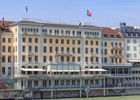 pablo picasso: Basel, Switzerland - 6 August, 2014: facade of the Grand Hotel Les Trois Rois, view from the Mittlere Brucke bridge over the Rhine river. Grand Hotel Les Trois Rois is a prestigious five-star hotel. Napoleon, Elizabeth II, Pablo Picasso, Thomas Mann and m Editorial