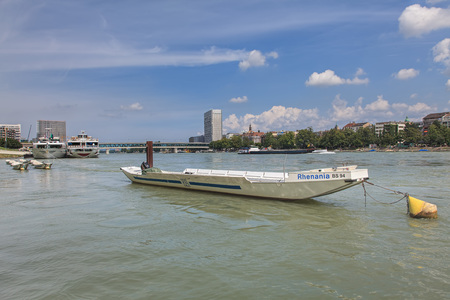 german swiss: Basel, Switzerland - 6 August, 2014: view on the Rhine river. Basel is Switzerlands third most populous city behind Zurich and Geneva, located where the Swiss, French and German borders meet.