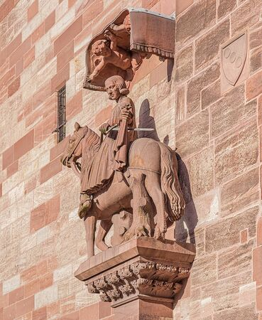 minster: Sculpture on the facade of the Basel Minster. The Basel Minster German: Basler Munster is one of the main landmarks and tourist attractions of the Swiss city of Basel. Stock Photo
