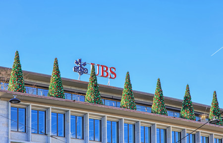 trees services: Zurich, Switzerland - 26 December, 2015: Christmas trees on the top of the UBS building on Paradeplatz square. UBS AG is a Swiss global financial services company, incorporated in the Canton of Zurich and co-headquartered in Zurich and Basel. The company