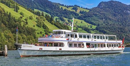 ms: Alpnachstad, Switzerland - 29 August, 2011: MS Gotthard at the pier on the Lake Alpnachersee, which is a branch of the Lake Lucerne. Lake Lucerne German: Vierwaldstattersee - Four Forested-Cantons Lake is a lake in central Switzerland, the fourth larges