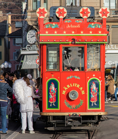 old time: Zurich, Switzerland - 6 December, 2015: old time Marlitram tram on the stop in Zurich Bellevue. Trams have been a consistent part of Zurichs cityscape since the 1880s, when the first horse tram ran, electrified from the 1890s. Editorial