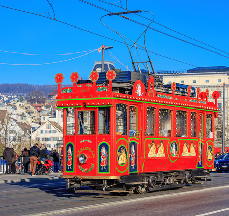 old time: Zurich, Switzerland - 6 December, 2015: old time Marlitram tram on the Quaibrucke bridge. Trams have been a consistent part of Zurichs cityscape since the 1880s, when the first horse tram ran, electrified from the 1890s.