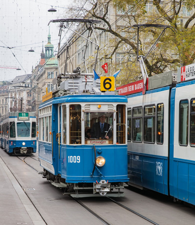 trams: Zurich, Switzerland - 6 December, 2015: trams on the Bahnhofstrasse street. Trams have been a consistent part of Zurichs cityscape since the 1880s, when the first horse tram ran, electrified from the 1890s.