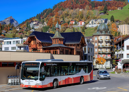 hill station tree: Engelberg, Switzerland - 12 October, 2015: bus at the Engelberg railway station entrance. Engelberg is a resort town and municipality in the canton of Obwalden. Editorial