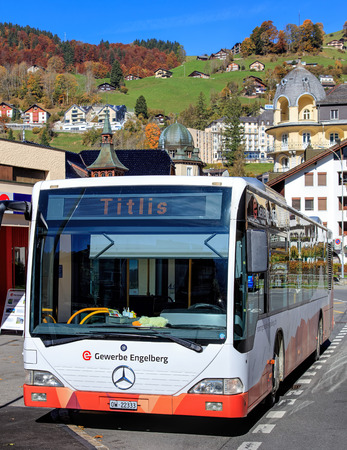 hill station tree: Engelberg, Switzerland - 12 October, 2015: bus at the Engelberg railway station entrance. Engelberg is a resort town and municipality in the Swiss canton of Obwalden.