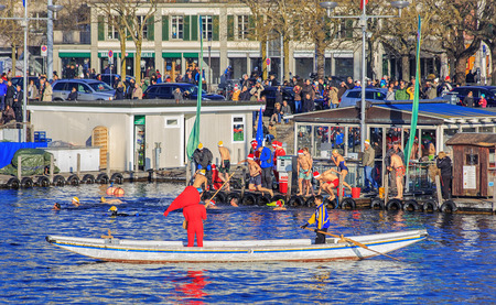 participants: Zurich, Switzerland - 6 December, 2015: participants of the Zurich Samichlaus-Schwimmen jumping into the water of the Limmat river. Zurich Samichlaus-Schwimmen began in the year 2000 with 65 participants and has developed into the second largest winter sw
