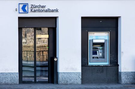 bankomat: Zurich, Switzerland - 18 January, 2016: entrance of the Zurich Cantonal Bank office on the Limmatquai quay. Zurich Cantonal Bank German: Zurcher Kantonalbank, or ZKB is the largest cantonal bank and fourth largest bank in Switzerland, wholly owned by the  Editorial