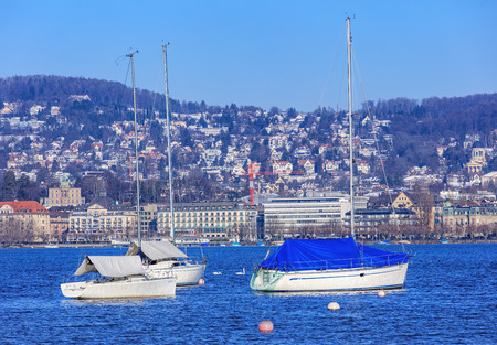 glarus: Zurich, Switzerland - 21 January, 2016: yachts on the Lake Zurich. Lake Zurich is a lake in Switzerland, extending southeast of the city of Zurich. It is formed by the Linth river, which rises in the glaciers of the Glarus Alps. Editorial
