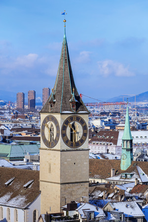 grossmunster cathedral: Tower of the St. Peter Church in Zurich, Switzerland, view from the tower of the Grossmunster cathedral in winter.
