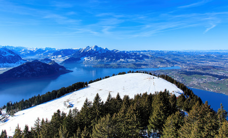 massif: View from Mt. Rigi in winter. The Rigi or Mount Rigi; also known as Queen of the Mountains is a mountain massif of the Alps, located in Central Switzerland.
