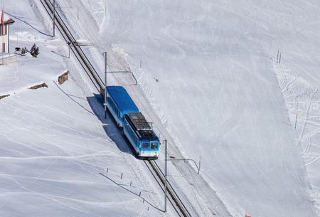 luft: Mt. Rigi, Switzerland - 25 January, 2016: Rigi Railways train. Rigi Railways German: Rigi Bahnen is a group of railways on Mount Rigi, they include two standard gauge rack railways, the Vitznau-Rigi Bahn VRB and the Arth-Rigi Bahn ARB, along with the Luft