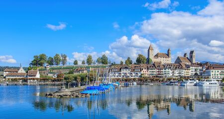 st gallen: Rapperswil, Switzerland - 7 September, 2015: view on the old town over the Lake Zurich. City of Rapperswil is a part of the municipality of Rapperswil-Jona in the Swiss canton of St. Gallen, located on the east side of the Lake Zurich. Editorial